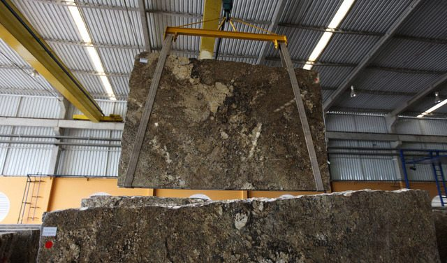large slab of granite hanging from ceiling
