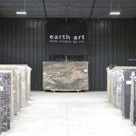 slabs of granite under earth art banner