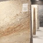 woman looking at slabs of granite