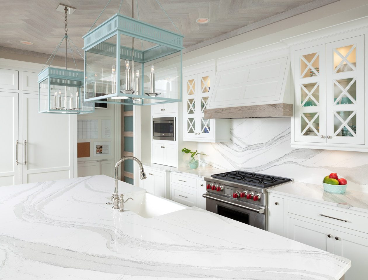 white kitchen with green lighting fixtures