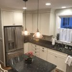 kitchen with black counters and beige cabinets